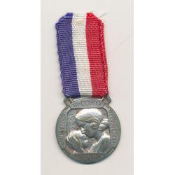 Médaille - Oeuvre des pupilles - femme et enfant