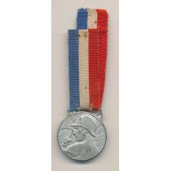 Médaille - Oeuvre des pupilles - Pompier avec hache
