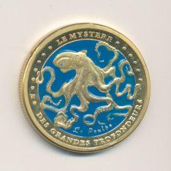 Médaille - Le mystère des grandes profondeurs - la cité de la mer - le scaphandrier - en couleur - 31mm